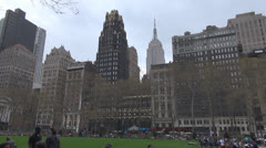 People relax in One Bryant Park by day, Midtown Manhattan New York City USA Stock Footage
