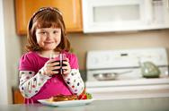 Kitchen girl: having juice with lunch Stock Photos