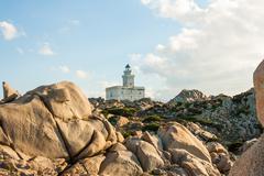 lighthouse at capo testa, sardinia - stock photo