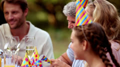 Family celebrating a birthday in the garden - stock footage