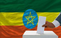 Man voting on elections in ethiopia in front of flag Stock Photos