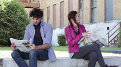War news - a man and a woman are reading on newspaper Stock Footage