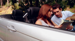 Couple in a silver car Stock Footage