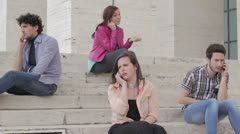 Various moods on a cell phone - young men and women with smartphone  Stock Footage