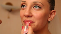 Fiancee paints her lips Stock Footage