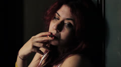 young woman smokes a joint to forget her problems - addict - drug - - stock footage