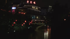 Fast motion of Boats on Xuanwu river by night, Nanjing, China Stock Footage