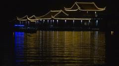 Boats on Xuanwu Lake by night, Nanjing, China Stock Footage