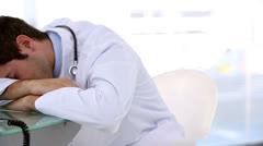 Sleeping doctor woken by his coworker Stock Footage