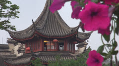 Building of Jiming Temple among flowers, Nanjing, China Stock Footage