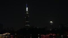 Zifeng Tower and Xuanwu Lake by night, Nanjing, China Stock Footage