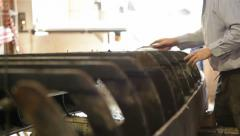 Artisan repairing boat Stock Footage