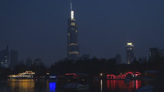Zifeng Tower and Xuanwu Lake in twilight, Nanjing, China Stock Footage