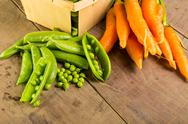 Stock Photo of fresh shelled peas and carrots
