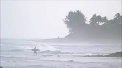 Surfer Walking in from a surf session Stock Footage