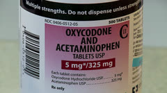 Oxycodone and hydrocodone pill bottles - stock footage
