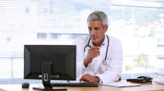 Doctor using his computer Stock Footage