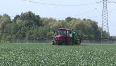 Agriculture tractor spraying  crop field in farm Stock Footage
