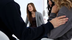 People comforting woman in a group therapy - stock footage