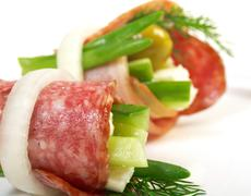canape platter with cheese, smoked sausage - stock photo