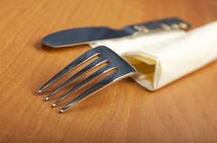 Fork and a knife lie on serviette Stock Photos