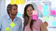 Creative team pointing adhesive notes Stock Footage