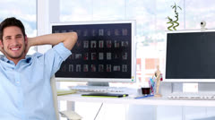 Smiling man in creative office Stock Footage