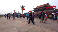 tourists walking in front of Tiananmen gate - stock footage