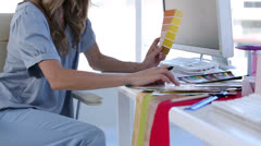 Interior designer looking at color chart Stock Footage