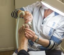treating foot by pedicure - stock photo