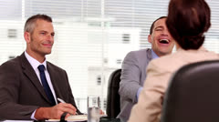 Smiling businessmen shaking hand of a job applicant Stock Footage