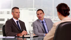 Businessmen talking to an applicant Stock Footage