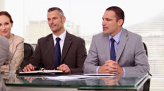 Job applicant shaking hands of business people Stock Footage