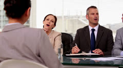 Cheerful job applicant laughing during an interview Stock Footage