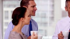 Business people having a coffee together Stock Footage