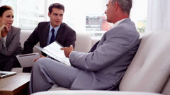 Business people discussing together on a couch Stock Footage