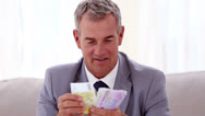 Stock Video Footage of Happy businessman counting banknotes