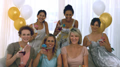 Women toasting with cocktail - stock footage