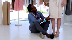 Fashion designer working on a bespoke dress Stock Footage