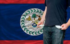 recession impact on young man and society in belize - stock photo