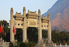 the facade of po lin temple in hong kong. - stock photo