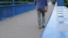 People walking over a Bridge Stock Footage
