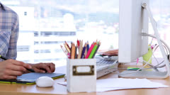 Serious graphic designer using graphics tablet Stock Footage