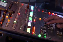 Adjust sound mixer switch in concert Stock Photos