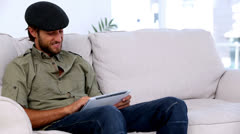 Man using tablet pc on the couch Stock Footage