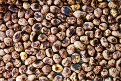 background of a heap of roasted peanuts. - stock photo