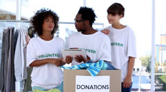 Group of volunteers talking together Stock Footage