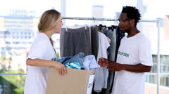 Volunteers storing clothes Stock Footage