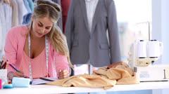 Fashion designer working Stock Footage