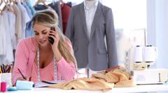 Fashion designer on the phone Stock Footage